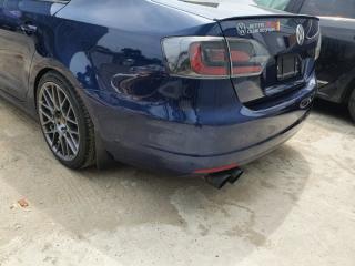 Бампер задний голый задний Volkswagen Jetta 2014