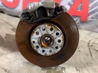 Тормозной диск передний правый Volkswagen Passat 2014 год