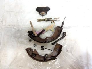 Механизм стояночного тормоза задний левый NISSAN LIBERTY 2002