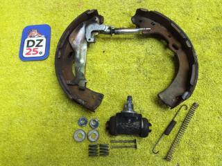Механизм стояночного тормоза задний левый NISSAN ELGRAND 1998