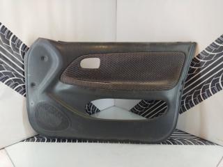 Обшивка двери передняя правая Toyota Corolla