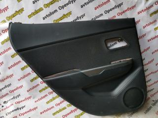 Обшивка двери задняя левая Kia Rio