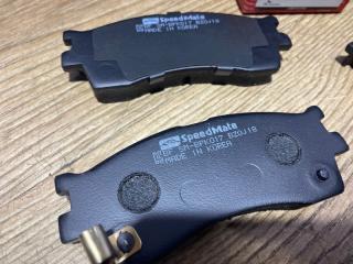 Тормозные колодки дисковые переднее Spectra