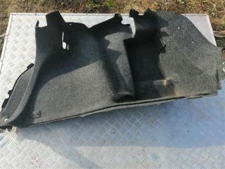 Запчасть обшивка багажника задняя левая Geely MK 2012