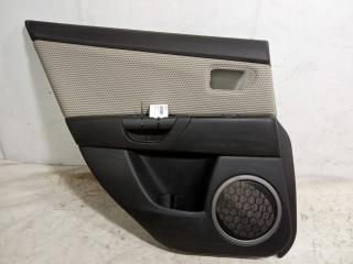 Запчасть обшивка двери задняя левая Mazda 3 2003-2009