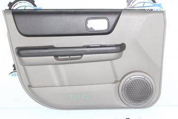 Обшивка двери передняя левая Nissan X-Trail 2002-2007