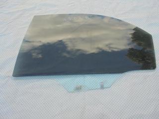 Запчасть стекло двери заднее левое Kia Spectra 2007