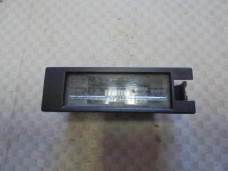 Запчасть фонарь подсветки номера Opel Corsa 2008