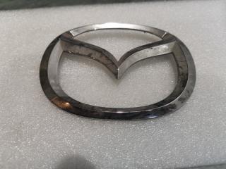 Запчасть эмблема задняя Mazda Mazda2 2007-2010