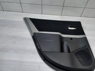 Запчасть обшивка двери задняя левая Toyota Yaris 2010