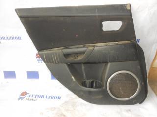 Запчасть обшивка двери задняя левая Mazda 3 2007