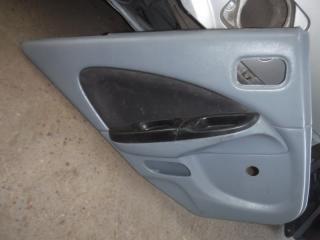 Запчасть обшивка двери задняя левая Nissan Almera 2006