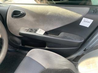 Обшивка двери передняя правая HONDA Fit