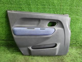 Запчасть обшивка двери передняя левая SUZUKI Chevrolet Cruze 2003