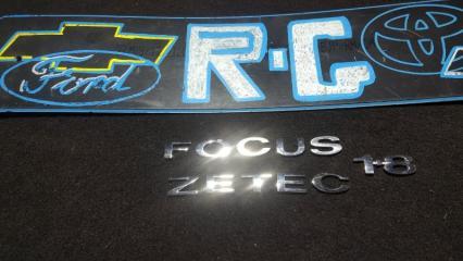 Запчасть шильдики крышки багажника Ford Focus 2